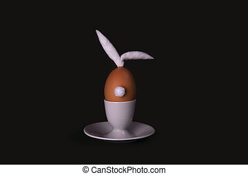Easter bunny egg with cotton tail and ears on dark background with copyspace. Moody minimalistic decoration concept. Stock photo.
