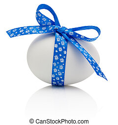 Easter egg with festive blue bow isolated on white background