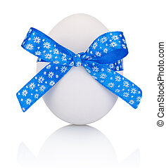 Easter egg with festive blue bow isolated on white ...