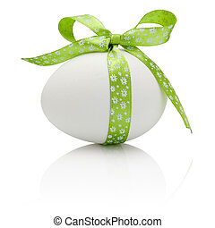 Easter egg with festive green bow isolated on white ...