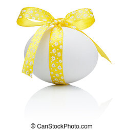 Easter egg with festive yellow bow isolated on white ...