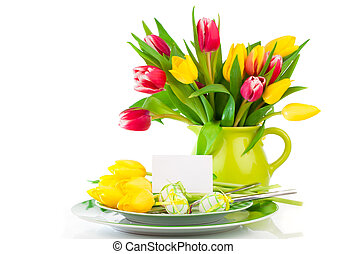 Easter eggs and blank for text in a plate, with tulips flowers on a white background