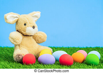 Easter eggs and bunny on grass