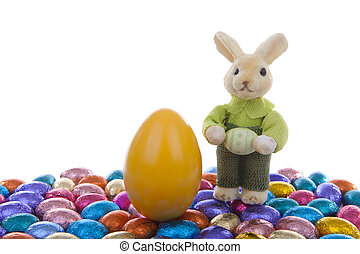 Easter eggs and bunny over white background