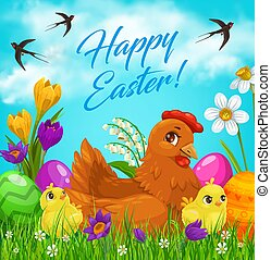 Easter eggs and chicks on green grass