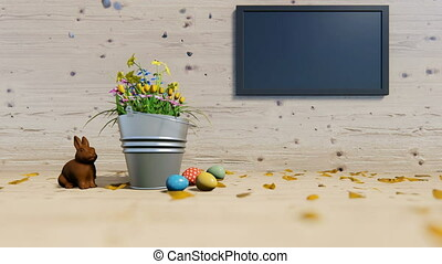 Easter eggs and chocolate rabbit near a flower bucket and...