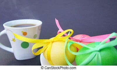 Easter eggs and Cup of coffee with steam