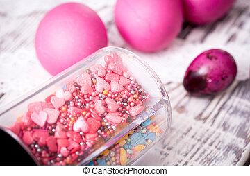 Easter eggs and decor on light background.