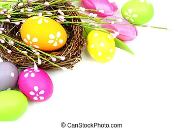 Easter eggs and nest with tulips forming a corner border...