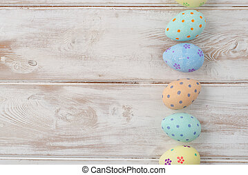 Easter Eggs Arranged in a Column with Copy Space