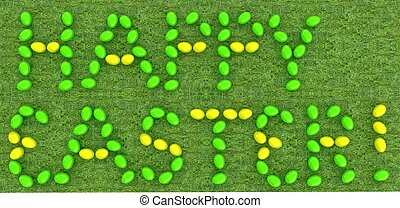 """Easter eggs as a """"Happy Easter"""" greeting on a green grass"""