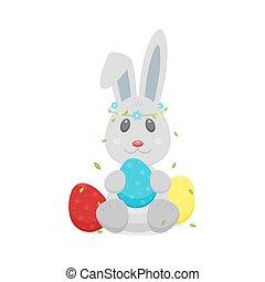 Easter eggs, bunny rabbit with wreath on head.