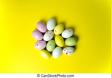 Easter eggs candy at yellow