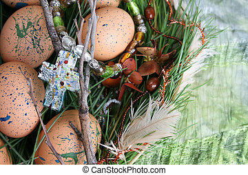 Easter Eggs - Decorated eggs in a wreath on a green ...