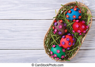 Easter eggs decorated with flowers top view
