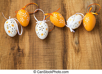 Easter eggs decoration painted with flowers on wooden background