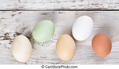 Easter Eggs: Five Different Eggs on rustic wood table