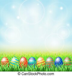 Easter eggs, green sunny meadow