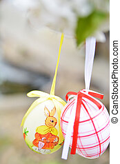 Easter eggs hanging on branch