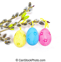 Easter eggs hanging on ribbons