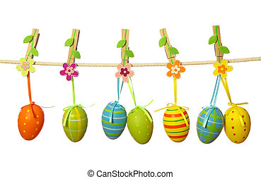 Easter eggs hanging on the clothesline isolated on white...