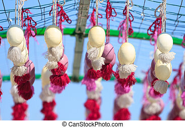 Easter eggs hanging on the ribbons