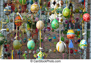 Easter eggs hung outdoors