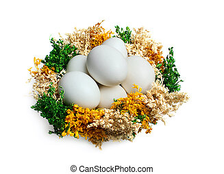 Easter eggs in a basket isolated on white background