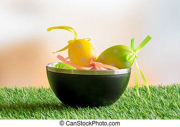 Easter eggs in a black bowl