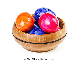 Easter eggs in a bowl on a white background