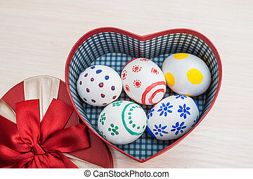 Easter eggs in a box in the shape of heart