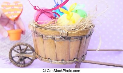 Easter eggs in a cart, behind put orange heart — clothespin...
