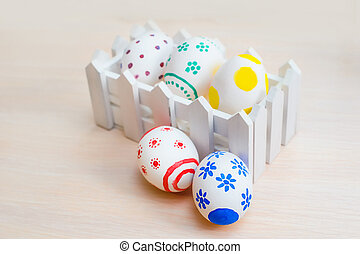 easter eggs in a paper holiday bag, Easter eggs on wooden background
