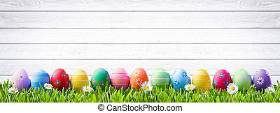 Easter Eggs In A Row And White Wooden Background