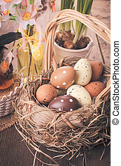 Easter eggs in basket - Brown and yellow eggs in basket,...