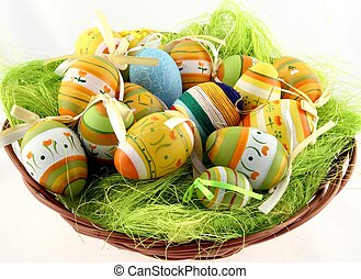 Easter eggs in basket. Isolated on white.