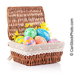 easter eggs in basket with yellow flowers
