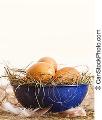 Easter eggs in blue bowl with straw