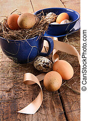 Easter eggs in blue cup with ribbons