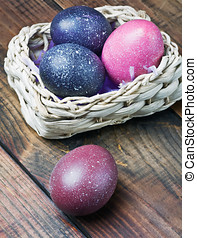 easter eggs in brown a basket on a wooden table
