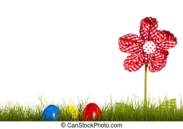 easter eggs in grass with drapery flower on white background