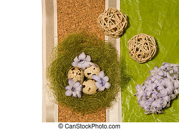 Easter eggs in nest and blue hyacinth