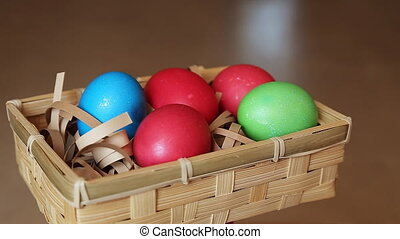 Easter eggs in rotate basket - Easter eggs in basket with...
