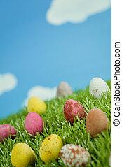 Easter Eggs in Spring - Macro shot of Easter eggs on grass.