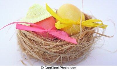Easter eggs in straw nest