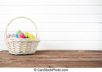 Easter eggs in the basket. Easter holiday concept.