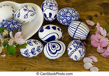 Easter eggs in the dish, on the wooden table, celebration, easter, religion