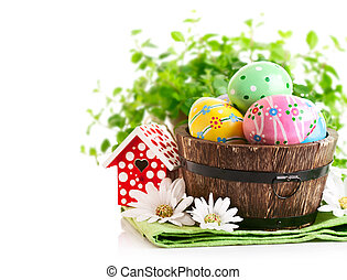 Easter eggs in the pot with green grass
