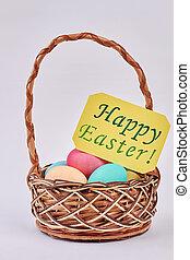 Easter Eggs in wicker basket.