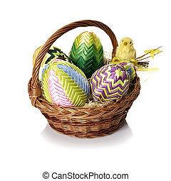 Easter eggs in wicker basket